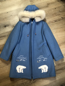 Kingspier Vintage - Northern Sun pure virgin wool northern parka in light blue. This parka features a hood with white fur trim, zipper closure, quilted lining, slash pockets, hidden inside knit cuffs, embroidered polar bear design on the front and back. Made in Canada.