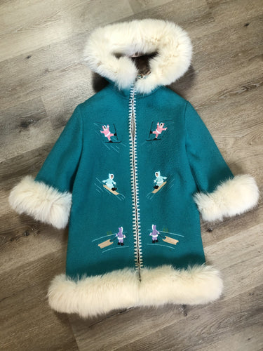 Kingspier Vintage - Children's Turquoise Wool Humber Handcrafts northern parka featuring a hood, white fur trim, zipper closure, lining, embroidered winter scenes along the front. Made in Canada.