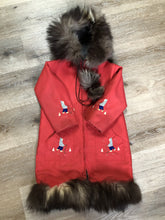 Load image into Gallery viewer, Children's red northern parka featuring a hood, fur trim and pom poms, zipper closure, wool lining, patch pockets, embroidered winter scenes along the front. Made in Canada.