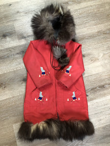 Kingspier Vintage - Children's red northern parka featuring a hood, fur trim and pom poms, zipper closure, wool lining, patch pockets, embroidered winter scenes along the front. Made in Canada.
