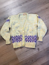 Load image into Gallery viewer, Hand knit cardigan in pale yellow with purple design and button closures. Size medium.