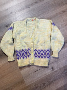 Hand knit cardigan in pale yellow with purple design and button closures. Size medium.
