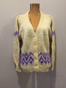 Kingspier Vintage - Hand knit cardigan in pale yellow with purple design and button closures. Size medium.