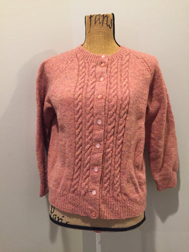 Hand Knit 100% wool cardigan in pink with cable knit stitch panel running down the center front. Size XS/S.