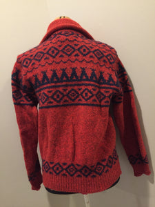 LL Bean cardigan in rust with navy blue design, zipper closure and vertical pockets. Made in the USA. Size medium (women).