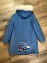 Load image into Gallery viewer, Northern Sun light blue pure virgin wool northern parka featuring a hood with white fur trim, zipper closure, quilted lining, slash pockets, hidden knit cuffs and arctic life design felt appliqué on the front and back. Made in Canada.