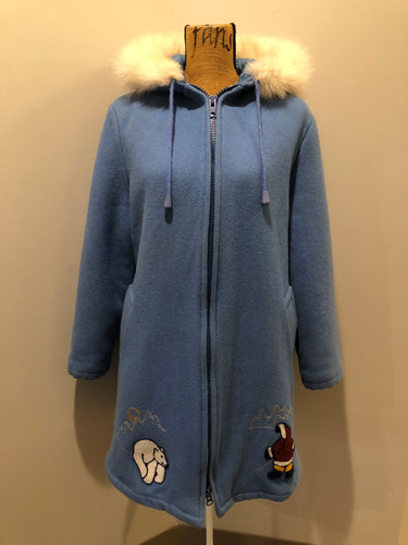 Kingspier Vintage - Northern Sun light blue pure virgin wool northern parka featuring a hood with white fur trim, zipper closure, quilted lining, slash pockets, hidden knit cuffs and arctic life design felt appliqué on the front and back. Made in Canada.