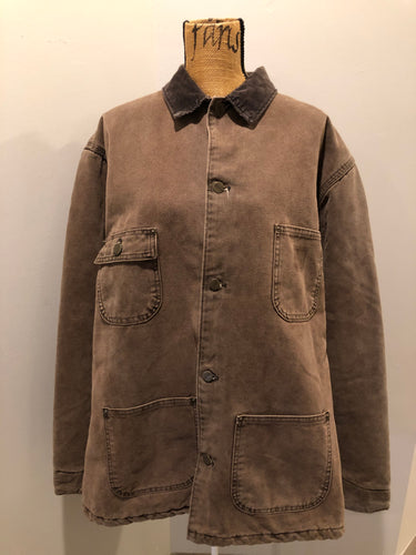 Carhartt brown chore jacket with brown corduroy collar, button closures, four patch pockets and a felted wool inside lining. Size XL