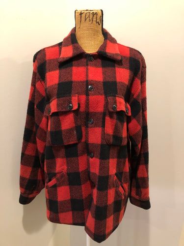 Sigal red wool blend lumberjack shirt with button closures, two flap pockets, two slash pockets. Made in Canada. Size large.