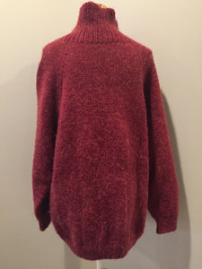 Raspberry red cardigan with zipper closure. Fibres are unknown. Size large.