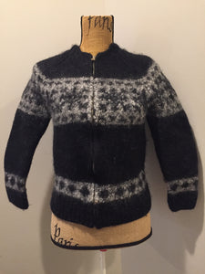 Hand knit cardigan in black and grey with zipper closure. Marked XL but fits more like a XS (women).