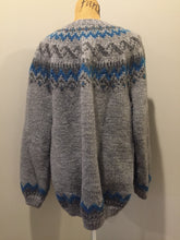 Load image into Gallery viewer, Hand knit Lopi style cardigan in grey and blue design with zipper. Made with synthetic fibres. Size large.