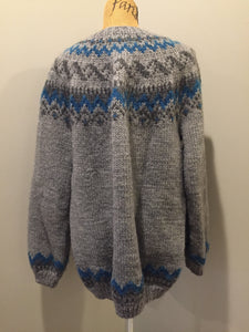 Hand knit Lopi style cardigan in grey and blue design with zipper. Made with synthetic fibres. Size large.