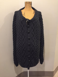 Hand knit honeycomb and cable stitch cardigan in charcoal grey with button closures. Fibres are unknown. Size XXL (mens).