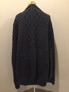 Kingspier Vintage - Hand knit honeycomb and cable stitch cardigan in charcoal grey with button closures. Fibres are unknown. Size XXL (mens).