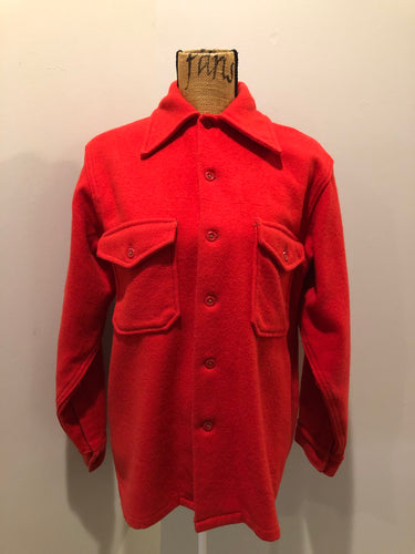Soo Wool vibrant red lumberjack shirt with button closures and two flap pockets on the chest. Made in the USA.