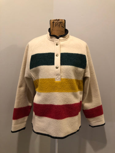 Woolrich 1970's wool half snap blanket sweater with green. red and yellow stripe. This sweater features half snap closures and a pouch pocket in the front.