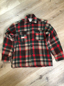 Regent wool blend lumberjack shirt in green, brown and red plaid with button closures and two flap pockets on the chest. Made in Canada.