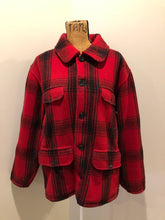Load image into Gallery viewer, Johnson Woolen Mills red plaid wool hunting jacket with button closures, inside knit cuffs to keep cold air out, four flap pockets, two hand warming pockets, two side zip pockets and one inside pocket.