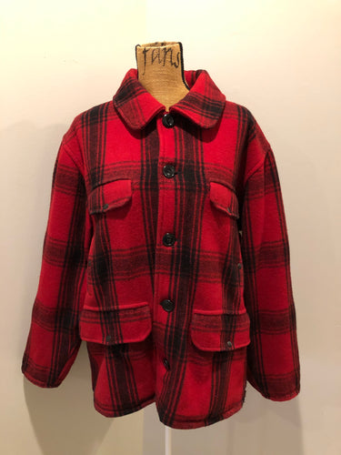 Johnson Woolen Mills red plaid wool hunting jacket with button closures, inside knit cuffs to keep cold air out, four flap pockets, two hand warming pockets, two side zip pockets and one inside pocket.