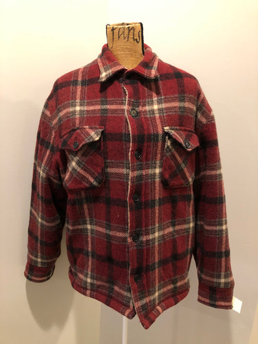 Woolrich Rugged Outdoor Wear red plaid wool jacket with button closures, two flap pockets and a fleece lining. Made in the USA. Size large.