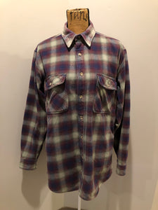 Kingspier Vintage - Herman Survivor faded blue red and green plaid lumberjack shirt with button closures and two flap pockets on the chest. Size large.