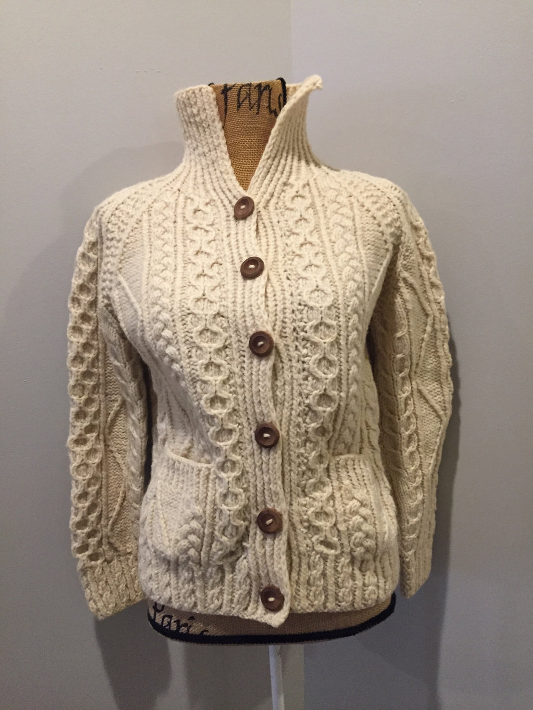 Fisherman's style honeycomb, diamond and braided knit wool cardigan in cream with button closures and patch pockets. Size small (womens).