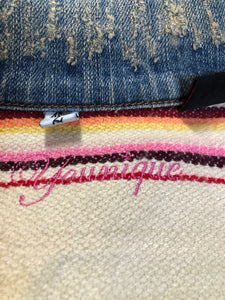 Kingspier Vintage - Younique denim jacket in a distressed light wash with colourful striped wool blend lining, button closures and two flap pockets. Size large, fits more like a medium.