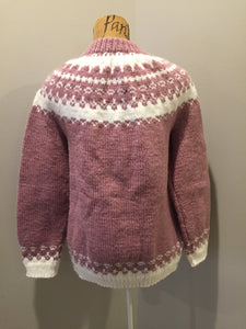 Hand knit Lopi style cardigan in pink and white. Fibers are synthetic.