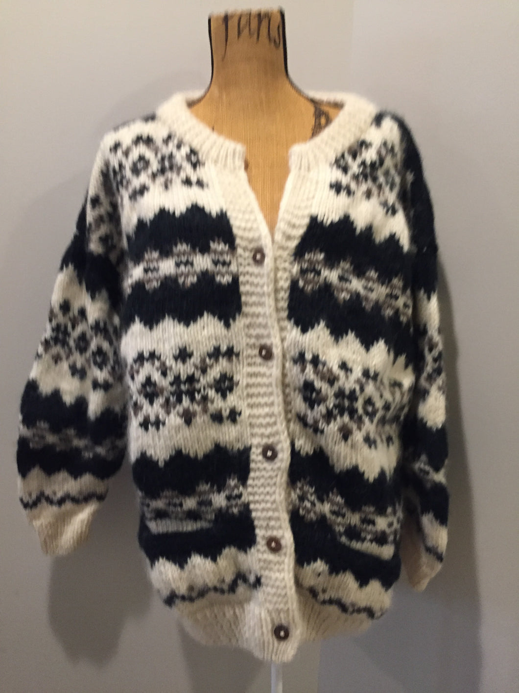 Kingspier Vintage - Vintage Casbah Imports wool cardigan in cream, black and brown with button closures and pockets. Size XXL.