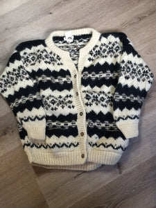 Vintage Casbah Imports wool cardigan in cream, black and brown with button closures and pockets. Size XXL.