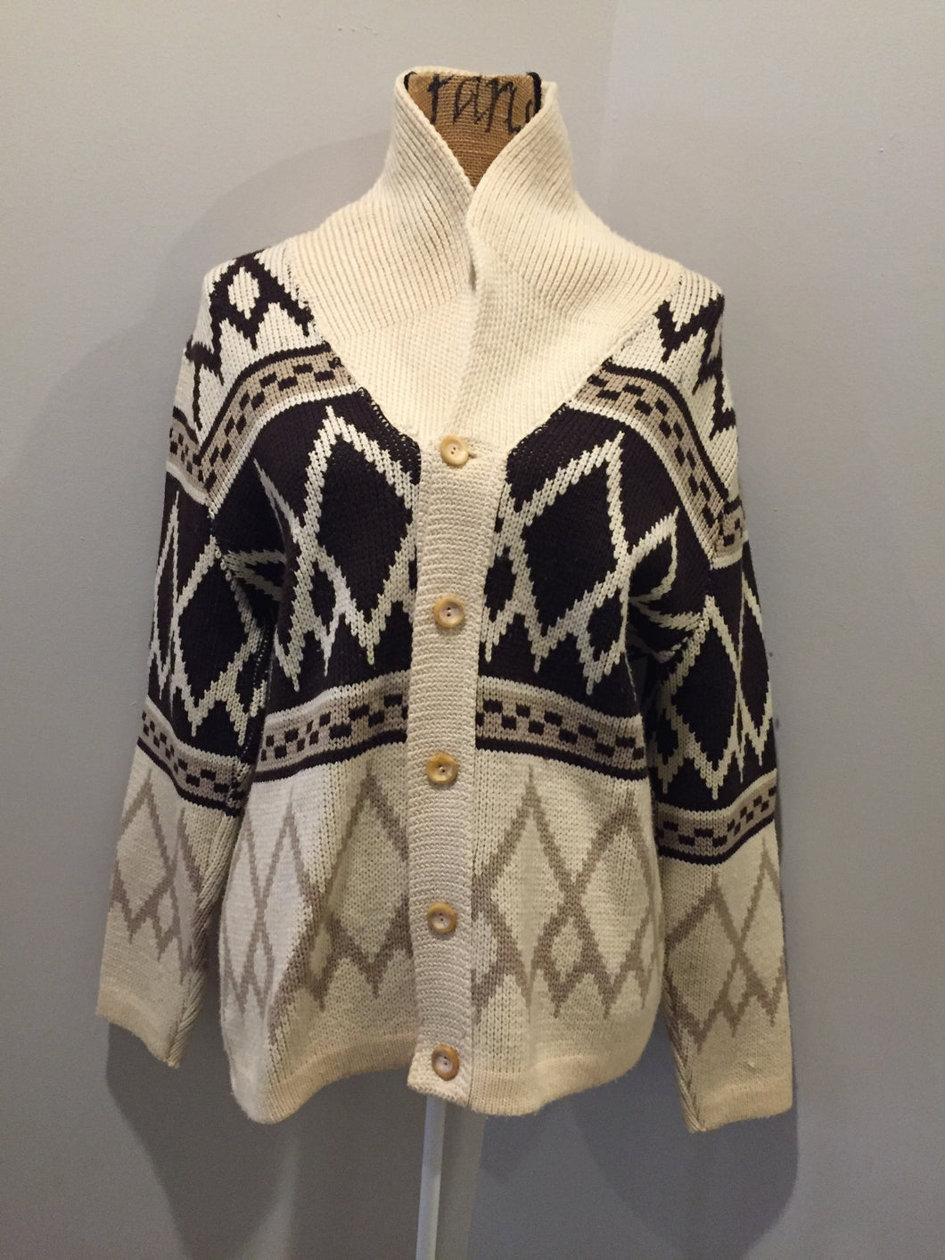 Tundra pure virgin wool cardigan in cream and brown with shawl collar and button closures. Made in Canada. Size medium