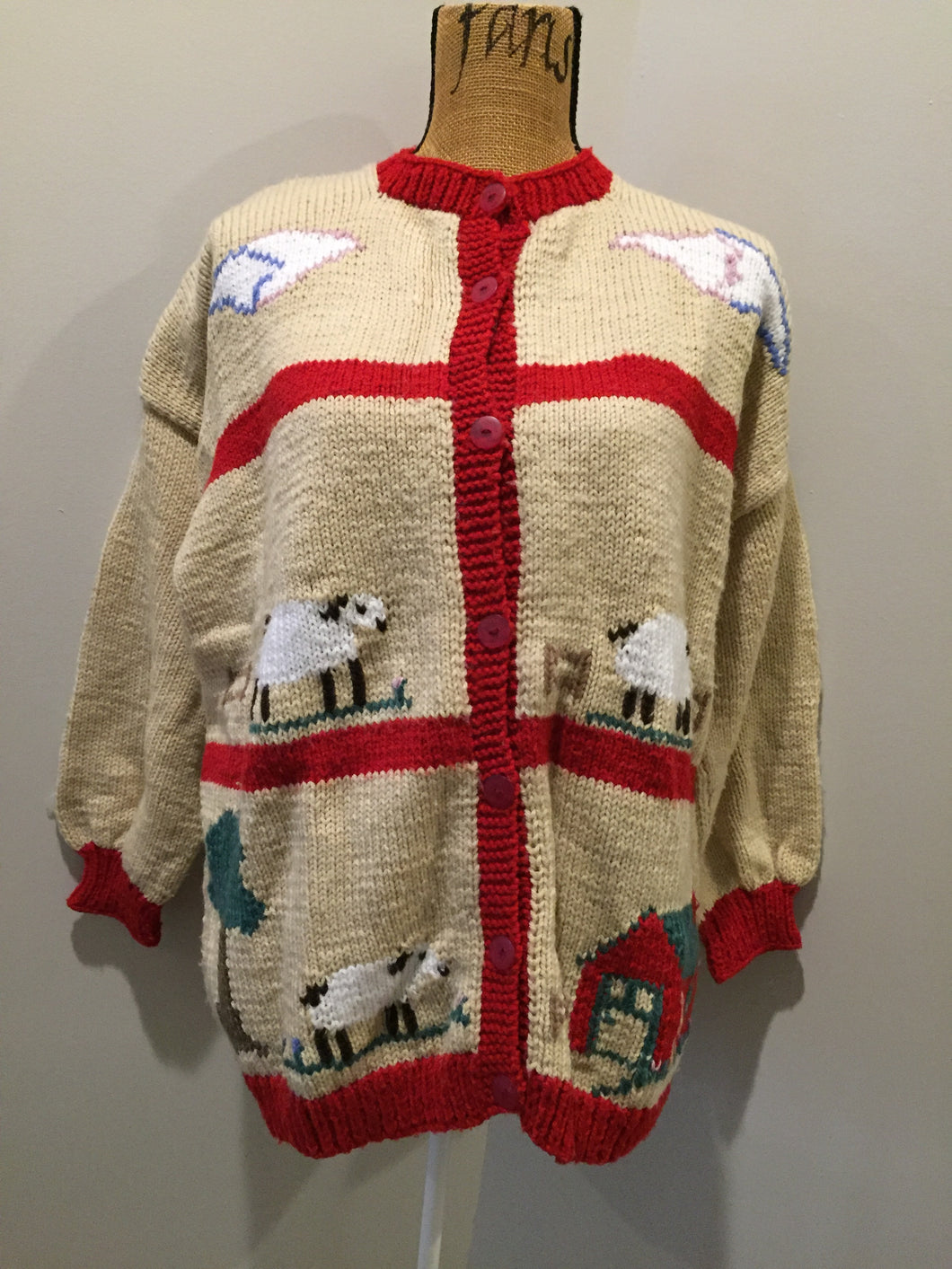 Kingspier Vintage - Hand knit cardigan in beige and red with sheep motif and buttons. Made with synthetic fibers.