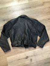 Load image into Gallery viewer, Cosa Nova black leather motorcycle jacket with two slash pockets, one flap pocket and a belt at the waist. Made in Canada. Size large.