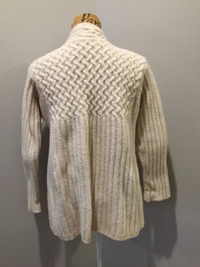 Kingspier Vintage - Vintage Inis Crafts merino wool cardigan in cream with one button closure at the collar. Size large.