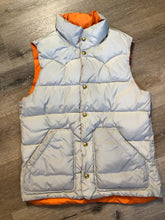 Load image into Gallery viewer, Scotch and Soda reversible orange and grey 1970's down filled puffer vest with snap closures and patch pockets. Made in Amsterdam.Scotch and Soda reversible orange and grey 1970's down filled puffer vest with snap closures and patch pockets. Made in Amsterdam.