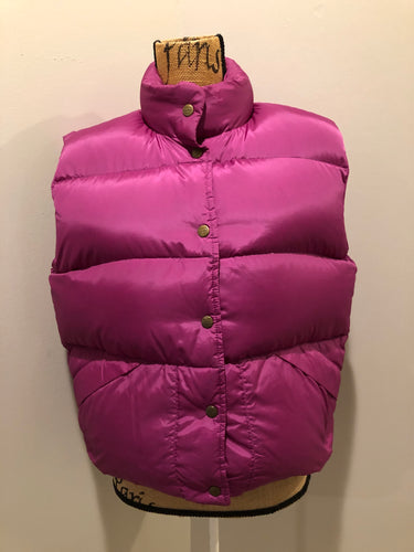 L.L.Bean dark pink down filled puffer vest with snap closures, slash pockets and is longer in the back. Size medium.