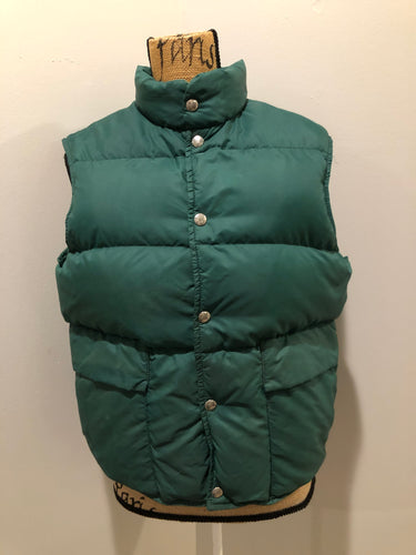 L.L.Bean forest green down filled puffer vest with snap closures, patch pockets and is longer in the back.