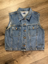 Load image into Gallery viewer, The Jeans Illegal Trademark denim vest with button closures and two flap pockets on the chest. Size medium.