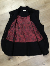 Load image into Gallery viewer, Venario black wool vest with red paisley lining, snap closures and flap pockets.