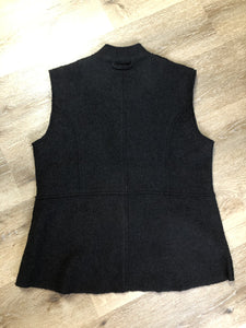 Venario black wool vest with red paisley lining, snap closures and flap pockets.