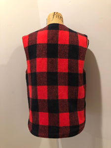 "Shane ""Weatherguard"" red and black plaid wool vest with snap closures and flap pockets. Made in the USA."
