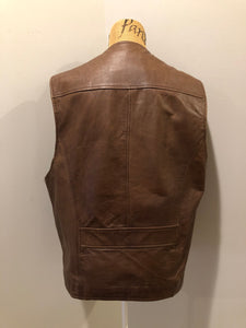 Danier medium brown leather vest with zipper and zip pockets. Size medium.