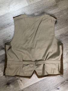 Ralph Lauren brown corduroy vest with button closures, four patch pockets and two inside pockets.