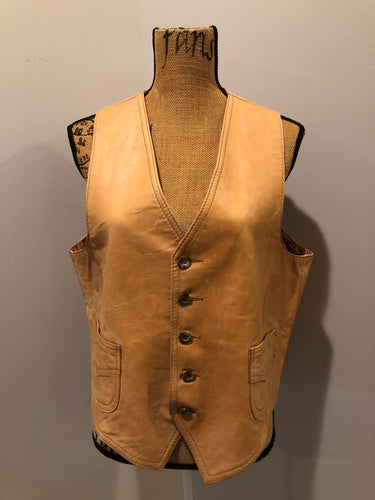 Cordovan tan leather vest with button closures and patch pockets.