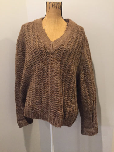 Hand knit short v-neck sweater in brown. Fibres are unknown.