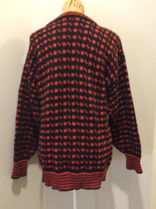 Hand knit black and red heritage print wool sweater. Made in Canada. Size L/XL.