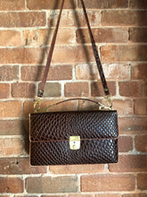 Load image into Gallery viewer, Dark brown reptile handbag with top handle, brass hardware, push button front clasp, detachable shoulder strap, inside pockets and leather lining.