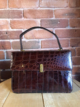 Load image into Gallery viewer, Bellestone red/brown lizard handbag, circa 1970's with top handle, leather lining, brass hardware and clasp closure.