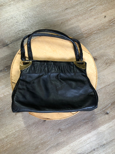 Jane Shilton black leather handbag with top handle, gold hardware and inside change purse compartment.
